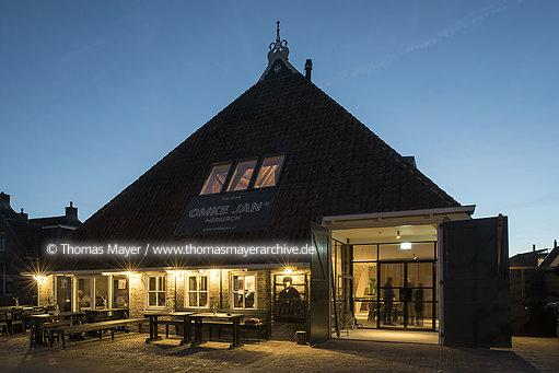 NLD, The Netherlands, Woudsend, traditional farm Jentsje is under monument protection and has been refurbished by Eek en Dekkers (Piet Hein Eek Architecure) and is now Omke Jan - restaurant and hotel