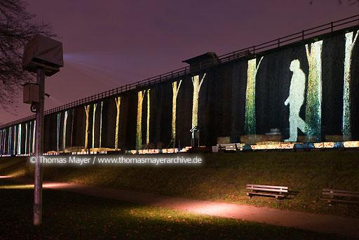 "2nd Projection-Biennale Bad Rothenfelde DEU, Germany, Bad Rothenfelde, ""Lichtsicht"", Manfred Schneckenburger furnishes the earlier salina with light projections. On the 1 kilometer long and 15 meter high salina various artists show light and sound performances after sunset. This projection is by Xavier de Richemont.  148AA20091108D4864"