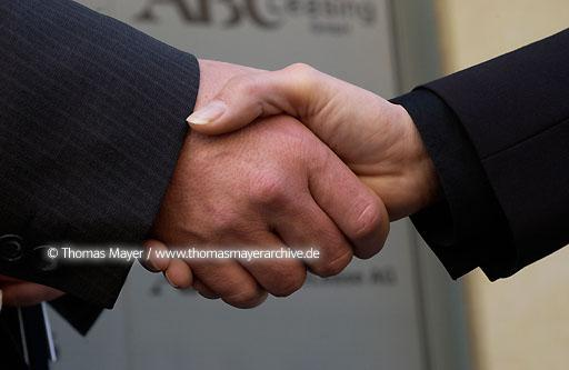 hands in office shake hands after signing a contract in an office in Cologne, Germany  075AB20020129D8773