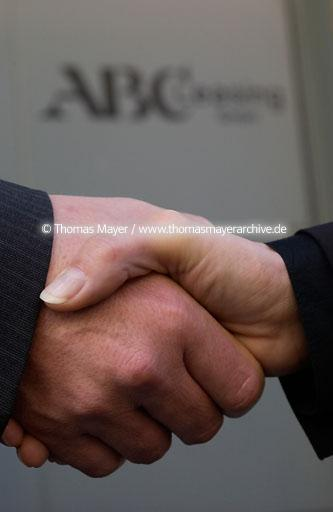 hands in office shake hands after signing a contract in an office in Cologne, Germany  075AB20020129D8776