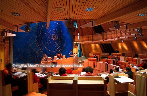 Sami Parliament Karasjok Karasjok, a small town north of the Arctic Circle, is the seat of the S�mediggi, the Parliament of the Norwegian S�mi people. The building includes features of their nomadically influenced culture: such as the plenary assembly hall, which is in the form of a tip. Architect: Stein Halvorsen, Oslo  115AA20011130A0067