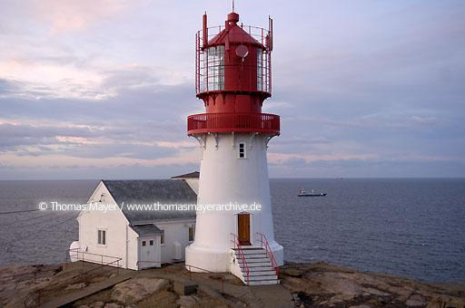 Lindesnes Lighthouse and museum at the south end of Norway meet Skagerrak and North Sea. Lindesnes lighthouse guides in it\'s present shape since 1915 ships sailing between Baltic Sea and North Sea  115AC20050227D0080
